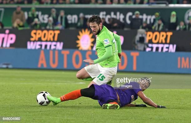 Christian Traesch of Wolfsburg and Serge Gnabry of Werder Bremen battle for the ball during the Bundesliga match between VfL Wolfsburg and Werder...