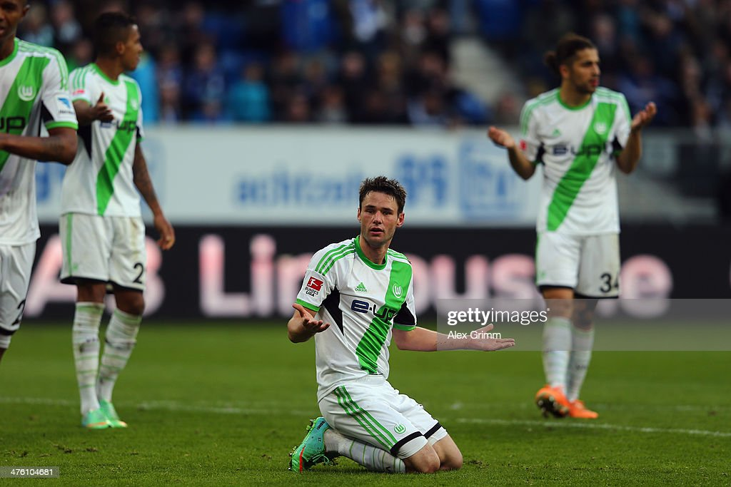 <a gi-track='captionPersonalityLinkClicked' href=/galleries/search?phrase=Christian+Traesch&family=editorial&specificpeople=5482851 ng-click='$event.stopPropagation()'>Christian Traesch</a> (C) of Wolfsburg reacts before being sent off by referee Markus Schmidt during the Bundesliga match between 1899 Hoffenheim and VfL Wolfsburg at Wirsol Rhein-Neckar-Arena on March 2, 2014 in Sinsheim, Germany.