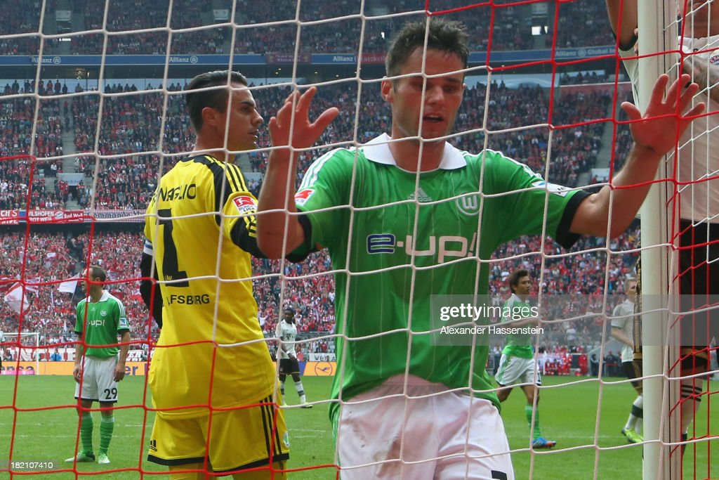 <a gi-track='captionPersonalityLinkClicked' href=/galleries/search?phrase=Christian+Traesch&family=editorial&specificpeople=5482851 ng-click='$event.stopPropagation()'>Christian Traesch</a> (R) of Wolfsburg reacts with his keeper <a gi-track='captionPersonalityLinkClicked' href=/galleries/search?phrase=Diego+Benaglio&family=editorial&specificpeople=543817 ng-click='$event.stopPropagation()'>Diego Benaglio</a> during the Bundesliga match between FC Bayern Muenchen and VfL Wolfsburg at Allianz Arena on September 28, 2013 in Munich, Germany.