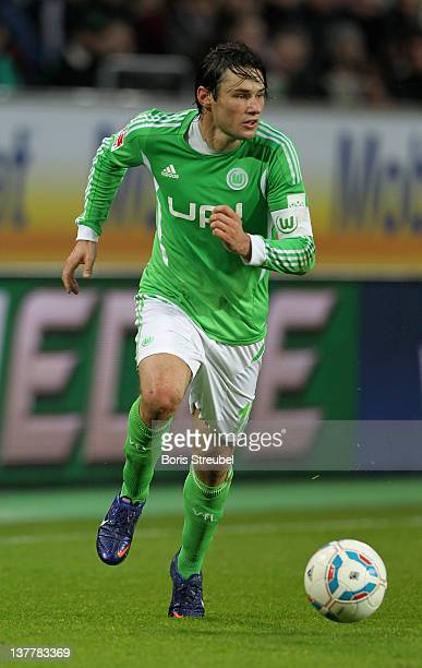 Christian Traesch of Wolfsburg runs with the ball during the Bundesliga match between VfL Wolfsburg and 1 FC Koeln at Volkswagen Arena on January 21...