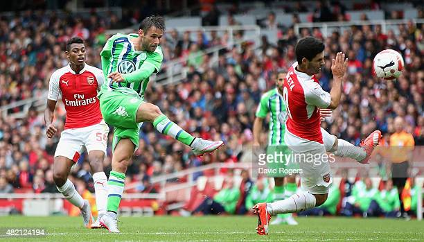 Christian Trasch of Wolfsburg take a shot during the Emirates Cup match between Arsenal and VfL Wolfsburg at the Emirates Stadium on July 26 2015 in...