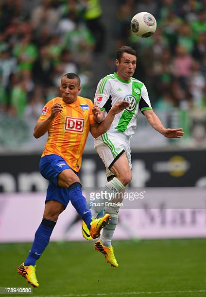 Christian Träsch of Wolfsburg challenges for the ball with Änis BenHatira of Berlin during the Bundesliga match between VfL Wolfsburg and Hertha BSC...