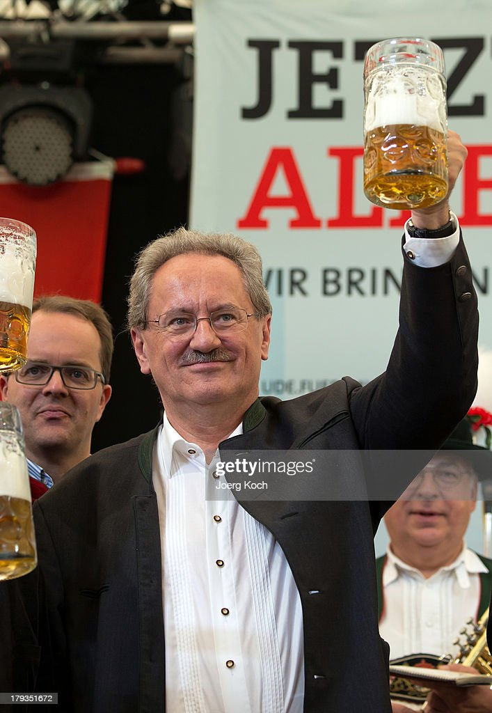 <a gi-track='captionPersonalityLinkClicked' href=/galleries/search?phrase=Christian+Ude&family=editorial&specificpeople=729442 ng-click='$event.stopPropagation()'>Christian Ude</a> (SPD), social democrats candidate for the bavarian election, proposes a toast with supporters at the annual Gillamoos beer tent day of politics on September 2, 2013 in Abensberg, Germany. Bavaria is scheduled to hold state elections on September 15, one week ahead of German federal elections scheduled for September 22.