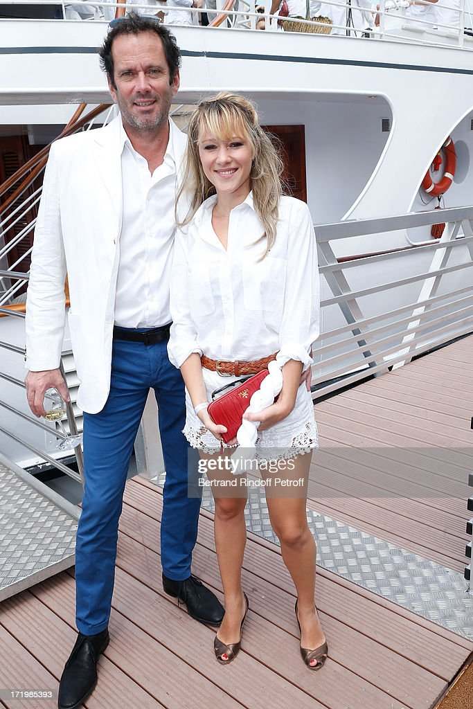 Christian Vadim (L) and his wife Julia Livage attend 'Brunch Blanc' hosted by Groupe Barriere for Sodexho with a cruise in Paris on June 30, 2013, France.