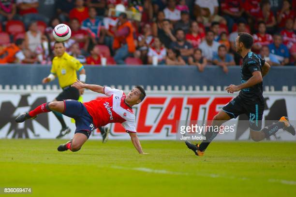 Christian Valdez of Veracruz attempts an overhead kick over Jonathan Bornstein of Queretaro during the fifth round match between Veracruz and...