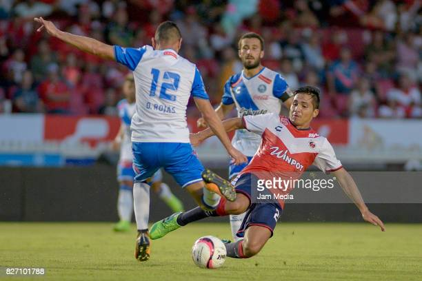 Christian Valdez of Veracruz fights for the ball with Oscar Rojas of Puebla during the 3rd round match between Veracruz and Puebla as part of the...