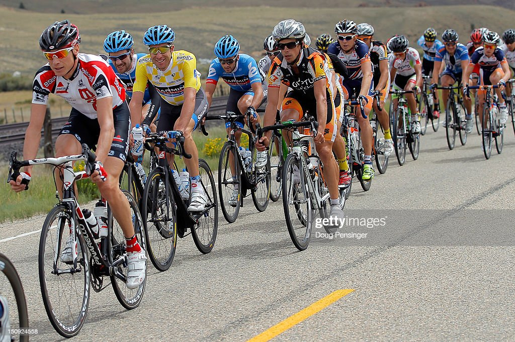 Christian Vande Velde (3L) riding for Garmin-Sharp in the overall race leader's yellow jersey rides in the peloton during stage four of the USA Pro Challenge from Aspen to Beaver Creek on August 23, 2012 in Twin Lakes, Colorado.