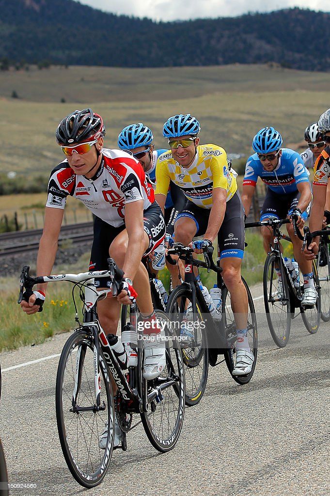 Christian Vande Velde (C) riding for Garmin-Sharp in the overall race leader's yellow jersey rides in the peloton during stage four of the USA Pro Challenge from Aspen to Beaver Creek on August 23, 2012 in Twin Lakes, Colorado.
