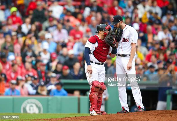 Christian Vazquez and Chris Sale of the Boston Red Sox talk on the mound during Game 4 of the American League Division Series against the Houston...
