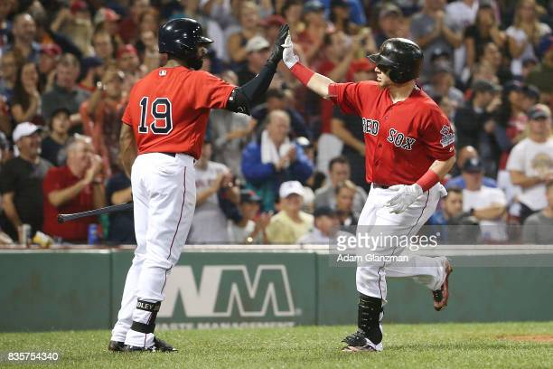Christian Vazquez high fives Jackie Bradley Jr #19 of the Boston Red Sox after hitting a solo home run in the fifth inning of a game against the New...
