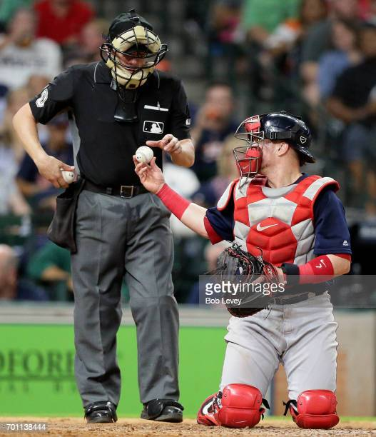 Christian Vazquez of the Boston Red Sox asks home plate umpire DJ Reyburn for a new ball against the Houston Astros at Minute Maid Park on June 16...