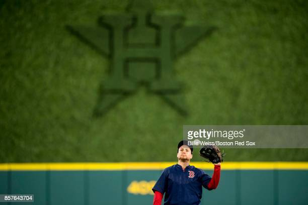 Christian Vazquez of the Boston Red Sox catches a ball during a workout before the American League Division Series against the Houston Astros on...