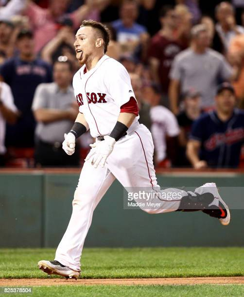 Christian Vazquez of the Boston Red Sox celebrates after hitting a three run homer in the ninth inning to defeat the Cleveland Indians 1210 at Fenway...