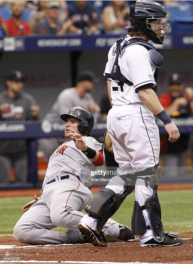 Christian Vazquez #55 of the Boston Red Sox crosses home plate ahead of catcher Ryan Hanigan #24 of the Tampa Bay Rays to score off of a double by Mookie Betts during the third inning of a game on September 1, 2014 at Tropicana Field in St. Petersburg, Florida.