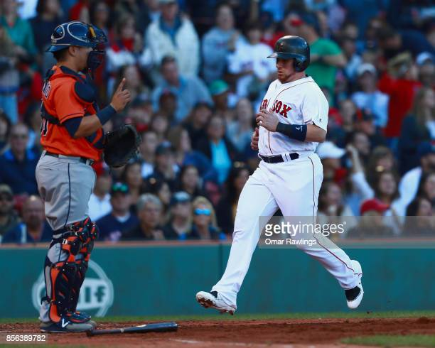 Christian Vazquez of the Boston Red Sox crosses the plate in the bottom of the fourth inning during the game against the Houston Astros at Fenway...
