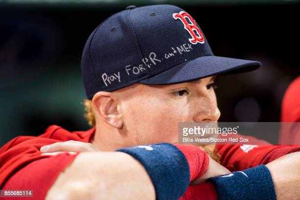 Christian Vazquez of the Boston Red Sox displays a message on his hat before a game against the Houston Astros on September 29 2017 at Fenway Park in...