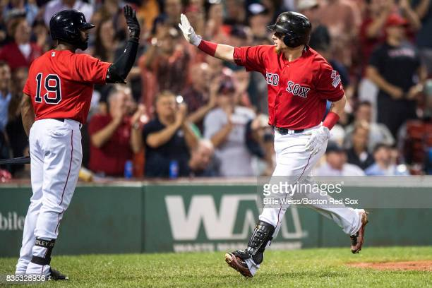 Christian Vazquez of the Boston Red Sox high fives Jackie Bradley Jr #19 after hitting a solo home run during the fifth inning of a game against the...