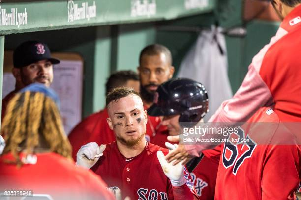 Christian Vazquez of the Boston Red Sox high fives teammates after hitting a solo home run during the fifth inning of a game against the New York...