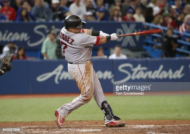 Christian Vazquez of the Boston Red Sox hits a tworun home run in the seventh inning during MLB game action against the Toronto Blue Jays at Rogers...