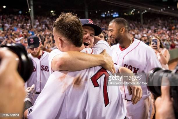 Christian Vazquez of the Boston Red Sox hugs Brock Holt after hitting a walkoff three run home run during the ninth inning of a game against the...