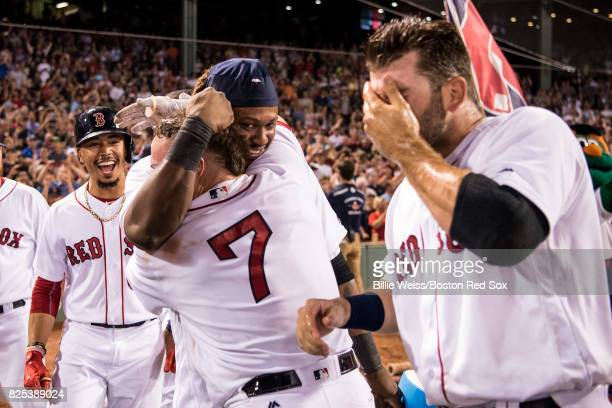 Christian Vazquez of the Boston Red Sox is mobbed by Hanley Ramirez Mookie Betts and Mitch Moreland after hitting a walkoff three run home run during...