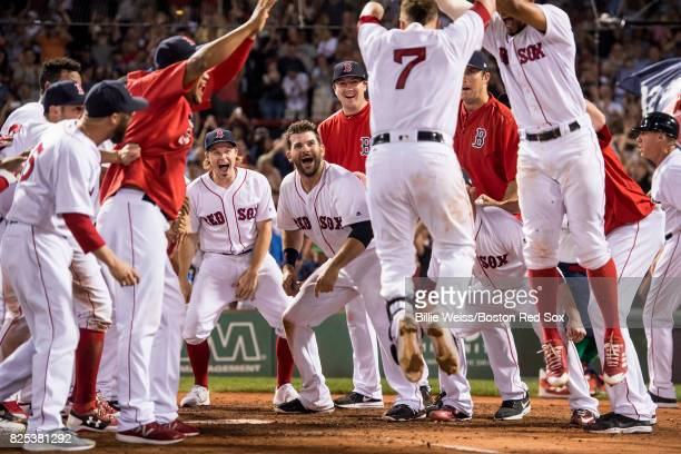 Christian Vazquez of the Boston Red Sox is mobbed by teammates after hitting a walkoff three run home run during the ninth inning of a game against...