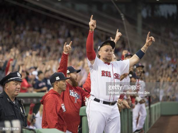 Christian Vazquez of the Boston Red Sox reacts after a threerun home run by Jackie Bradley Jr against the Houston Astros in the seventh inning of...