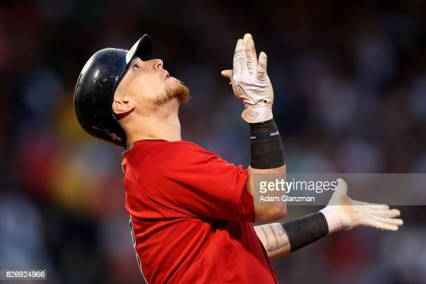 Christian Vazquez of the Boston Red Sox reacts after hitting a single during a game against the Chicago White Sox at Fenway Park on August 4 2017 in...