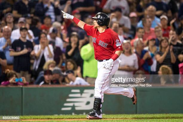 Christian Vazquez of the Boston Red Sox reacts after hitting a solo home run during the fifth inning of a game against the New York Yankees on August...