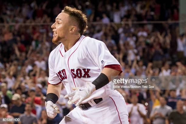 Christian Vazquez of the Boston Red Sox reacts after hitting a walkoff three run home run during the ninth inning of a game against the Cleveland...
