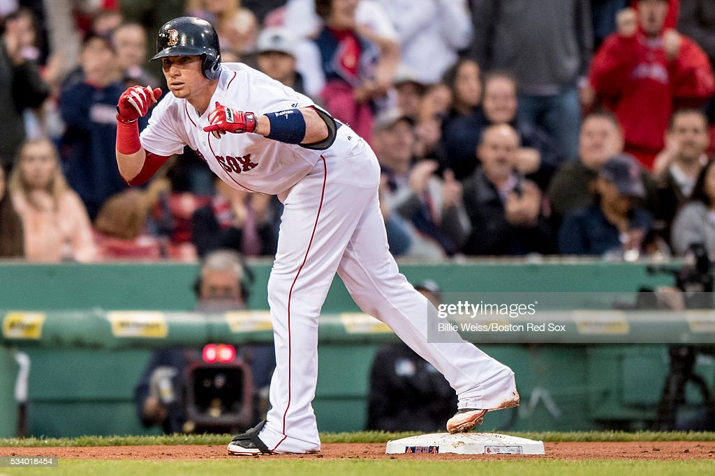 Christian Vazquez #7 of the Boston Red Sox reacts after hitting an RBI triple during the second inning of a game against the Colorado Rockies on May 24, 2016 at Fenway Park in Boston, Massachusetts.