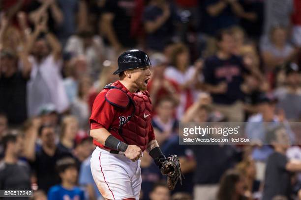 Christian Vazquez of the Boston Red Sox reacts after picking off a runner at second base during the eleventh inning of a game against the Chicago...