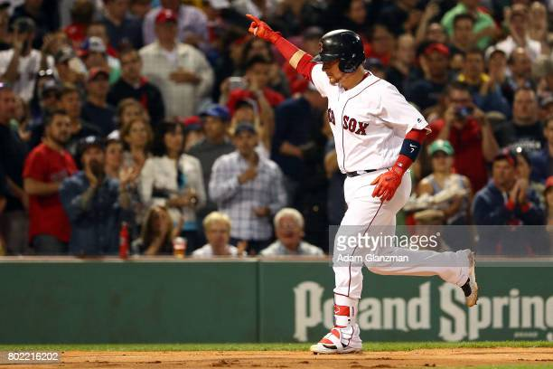 Christian Vazquez of the Boston Red Sox reacts as he crosses home plate after hitting a tworun home run in the second inning of a game against the...