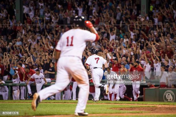 Christian Vazquez of the Boston Red Sox rounds the bases after hitting a walkoff three run home run during the ninth inning of a game against the...