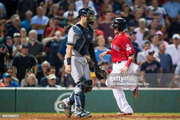 Christian Vazquez of the Boston Red Sox scores on a sacrifice fly during the seventh inning of a game against the New York Yankees on August 18 2017...