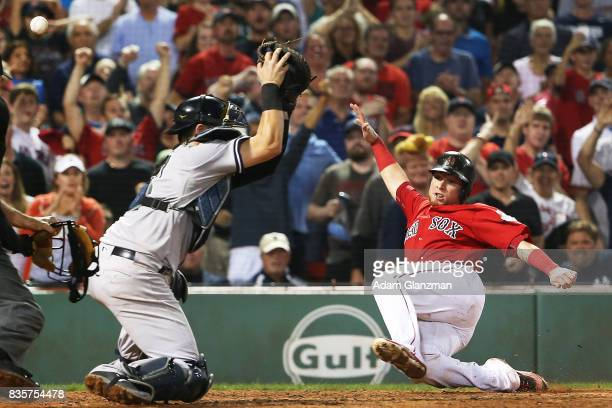Christian Vazquez of the Boston Red Sox slides safely into home ahead of the throw to Austin Romine of the New York Yankees in the eighth inning of a...