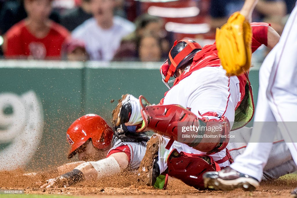 Christian Vazquez #7 of the Boston Red Sox tags out Johnny Giavotella #12 of the Los Angeles Angels of Anaheim as he attempts to score on a suicide squeeze play during the eighth inning of a game on July1, 2016 at Fenway Park in Boston, Massachusetts.