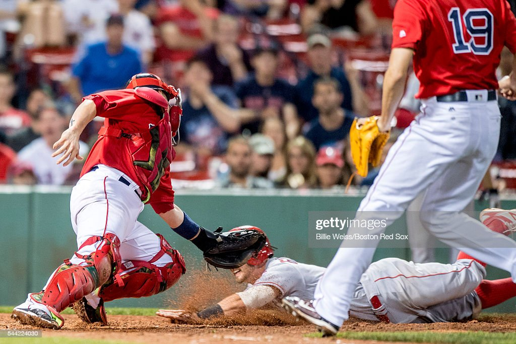 Christian Vazquez #7 of the Boston Red Sox tags out <a gi-track='captionPersonalityLinkClicked' href=/galleries/search?phrase=Johnny+Giavotella&family=editorial&specificpeople=7512348 ng-click='$event.stopPropagation()'>Johnny Giavotella</a> #12 of the Los Angeles Angels of Anaheim as he attempts to score on a suicide squeeze play during the eighth inning of a game on July1, 2016 at Fenway Park in Boston, Massachusetts.