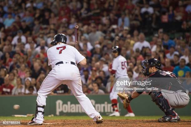 Christian Vazquez of the Boston Red Sox takes a wild pitch that gets past Yan Gomes of the Cleveland Indians during the ninth inning of a game on...