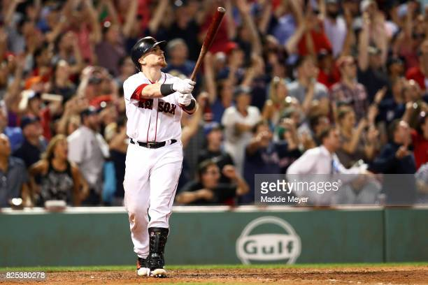 Christian Vazquez of the Boston Red Sox watches his three run homer to defeat the Cleveland Indians 1210 at Fenway Park on August 1 2017 in Boston...