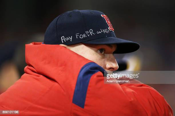 Christian Vazquez of the Boston Red Sox wears a hat the says pray for PR and Mex during a game against the Houston Astros at Fenway Park on September...
