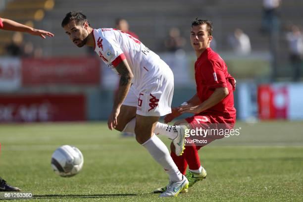 Christian Ventola of Teramo Calcio 1913 compete for the ball with Nicola Madonna of Padova Calcio during the Lega Pro 17/18 group B match between...