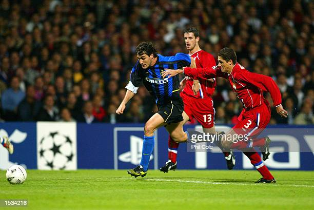 Christian Vieri of Inter Milan takes on Edmilson of Lyon during the UEFA Champions League First Phase Group D match between Lyon and Inter Milan at...