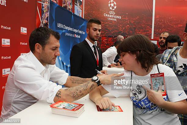 Christian Vieri signs on the fan tshirt during the UEFA Champions League Trophy Tour 2012/13 on October 19 2012 in Rome Italy