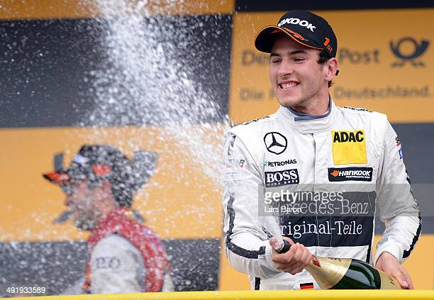 Christian Vietoris of Germany and Mercedes HWA celebrates after winning the second round of the DTM 2014 German Touring Car Championship at...