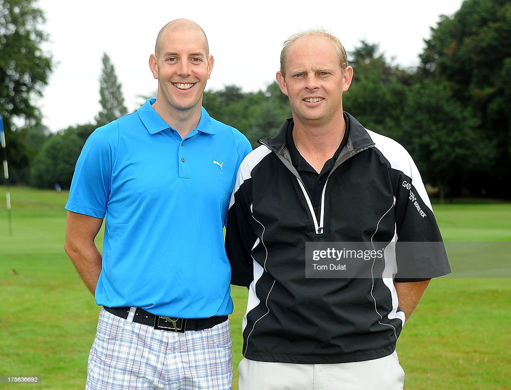 Christian Vine of Woodbury Park & Hotel Golf Club (R) and Kevin Harper of Sidmouth Golf Club (L) pose for photos during the Golfbreaks.com PGA Fourball Regional Qualifier at Exeter Golf and Country Club on August 5, 2013 in Exeter, England.
