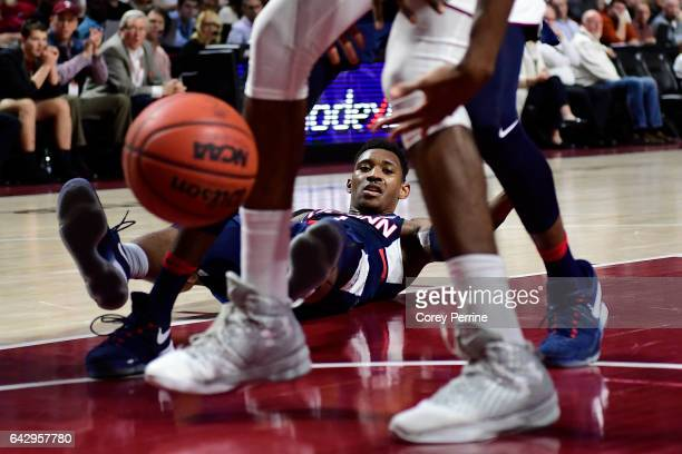 Christian Vital of the Connecticut Huskies looses the ball and his footing against the Temple Owls during the first half at the Liacouras Center on...