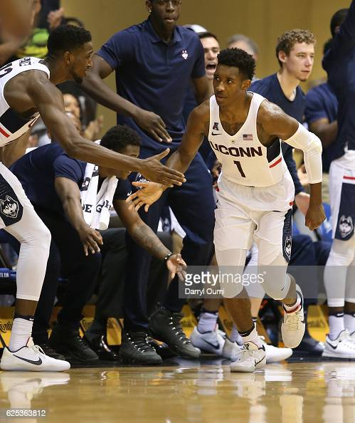 Christian Vital of the UConn Huskies gets handshake from teammate Kentan Facey after making a basket during the second half of the Maui Invitational...
