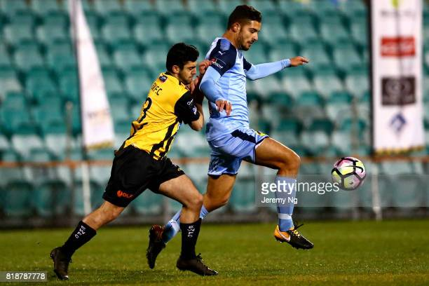Christian Vloutis of the Wanderers and Nicola Kuleski of Sydney FC challenge for the ball during the 2017 Johnny Warren Challenge match between...