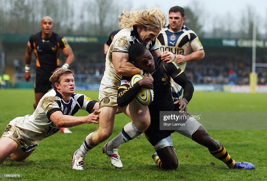 Christian Wade of London Wasps is tackled by Tom Biggs of Bath Rugby on his way to scoring a try during the Aviva Premiership match between London Wasps and Bath at Adams Park on January 6, 2013 in High Wycombe, England.